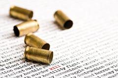 Bullet shells over violence. Bullet shells over words depicting violence, death etc Royalty Free Stock Photos