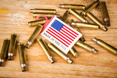 Bullet shells and US flag Royalty Free Stock Photos