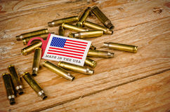 Bullet shells and US flag Royalty Free Stock Image