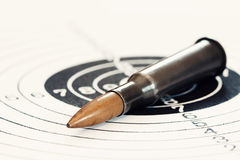 Bullet. Single rifle bullet on paper target for shooting practice Royalty Free Stock Images