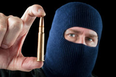 Bullet and terrorist Stock Photo