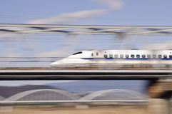 Bullet train. Japanese high speed train is passing over the bridge Royalty Free Stock Images