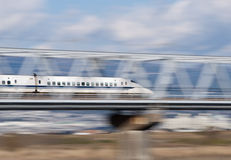 Bullet train. Japanese high speed train is passing over the bridge Stock Image