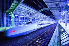 Bullet Train. Japan's Bullet Train makes a brief stop in Kyoto, JP. The Tokkaido Shinkansen is the world's busiest high-speed rail line carrying 151 million Stock Photo
