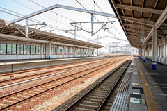 Bullet train station tracks and loading. Train station loading platfowm with tracks Stock Photos