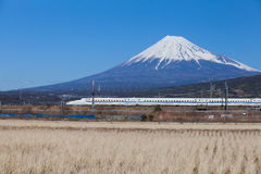 Bullet train Tokaido Shinkansen with view of mountain fuji royalty free stock photos