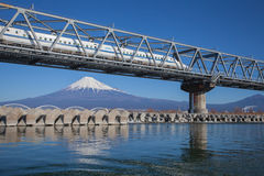 Bullet train Tokaido Shinkansen with view of mountain fuji at Shizuoka Stock Photos