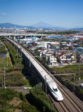 Bullet train Tokaido Shinkansen with view of mountain fuji Royalty Free Stock Photo