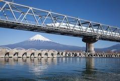 Bullet train Tokaido Shinkansen with view of mountain fuji stock images