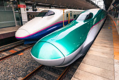 Bullet trains at Tokyo station. Tokyo, Japan - March 16, 2016: Series E5 and series E2 shinkansen 'bullet trains' waiting to depart at Tokyo station Royalty Free Stock Photography