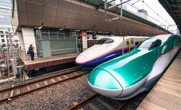 Bullet trains at Tokyo station. Tokyo, Japan - March 16, 2016: Series E5 and series E2 shinkansen 'bullet trains' waiting to depart at Tokyo station Stock Image