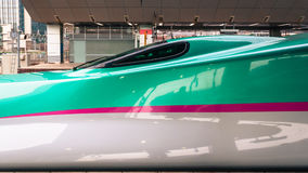 Bullet trains at Tokyo station. Tokyo, Japan - March 16, 2015: Side view of a series E5 shinkansen 'bullet train' at Tokyo station Royalty Free Stock Image