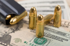 Bullet on US dollar banknotes Royalty Free Stock Image