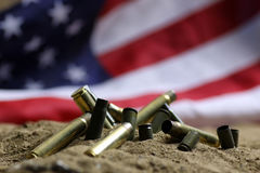 Bullet and usa flag in sand of war Royalty Free Stock Image
