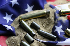Bullet and usa flag in sand war Royalty Free Stock Images