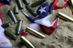 Bullet and usa flag in the sand war Royalty Free Stock Photos