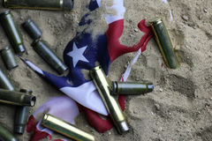 Bullet and usa flag in the sand war Royalty Free Stock Images