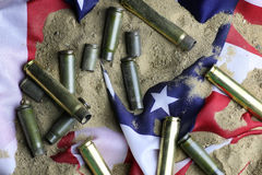 Bullet and usa flag in the sand war Royalty Free Stock Photo