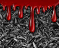 Bullet Violence. With blood dripping down over a group of different calibre bullets representing the risk of violent crime and security for social issues Stock Photos