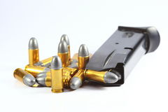 Bullet in white background. Gun and bullet in white background Royalty Free Stock Images