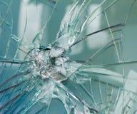 Bullethole d'armes à feu sur le verre des balles, fond de fissures Image libre de droits