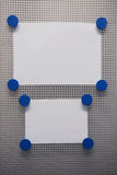 Bulletin Board. Magnet Bulletin Board with blue magnets on a silver metalboard Stock Image