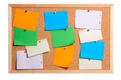 Bulletin board. Multi-coloured pieces of paper on a bulletin board Stock Photography