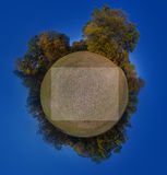 Bulletin board. Autumn landscape as a small planet in the blue sky background Stock Photo