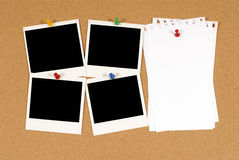 Photo album, several polaroid frames pinned to cork notice board with untidy torn notepaper, copy space Stock Photography