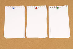 Torn note paper pinned to cork notice board background, copy space Stock Photo
