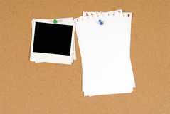Single Polaroid photo frame, torn white note paper on cork background, copy space Stock Image