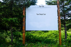 Bulletin board in forest Stock Image