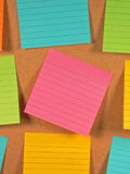Bulletin Board Notes. A colorful array of notes on a bulletin board Stock Images