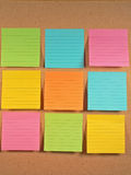 Bulletin Board Notes. A colorful array of notes on a bulletin board Stock Photo