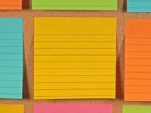 Bulletin Board Notes. A colorful array of notes on a bulletin board Royalty Free Stock Photos