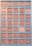 Bulletin board with terracotta professions.Orvieto Italy. Bulletin board with pottery arts, professions and coats of arms of the districts of Orvieto Italy Royalty Free Stock Photos