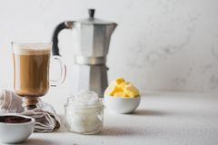 BULLETPROOF COFFEE. Ketogenic keto diet coffe blended with coconut oil and butter. Cup of bulletproof coffee and. Ingredients on white background. Copy space stock photos