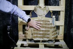 Bulletproof military vest. A man is inspecting a bulletproof military vest Royalty Free Stock Images