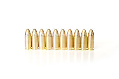 Bullets. 9mm bullets in row isolated on white Stock Images