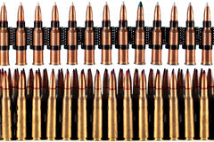 Bullets. A lot of machine gun bullets on the white background Stock Images