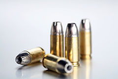 Bullets 9mm closeup. Bullets 9mm - closeup of 9mm silvertipped rounds on a cold brushed metal background Royalty Free Stock Photography