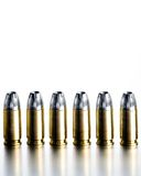 Bullets 9mm high contrast. Bullets 9mm closeup on brushed metal, white background, high contrast stock photos