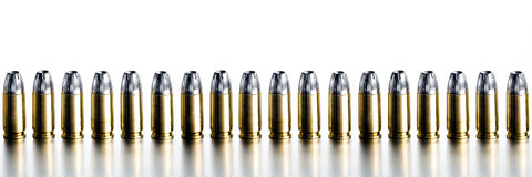 Bullets 9mm high contrast banner. Bullets 9mm border / banner - closeup on brushed metal, white background stock images