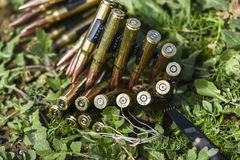 Bullets in ammunition belts outdoor for machine gun Royalty Free Stock Image