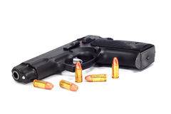 Bullets. And automatic pistol on white background Stock Photos