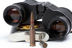 Bullets, binoculars and flask Royalty Free Stock Image