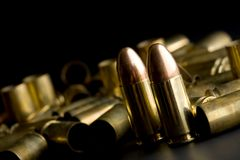 Bullets on black Stock Photography