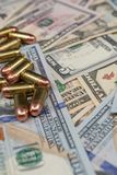 Bullets  close-up on a pile of United States currency. stock photography