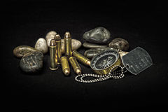 Bullets and compass. And stone Stock Photography