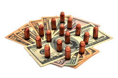 Bullets and dollars Stock Photography